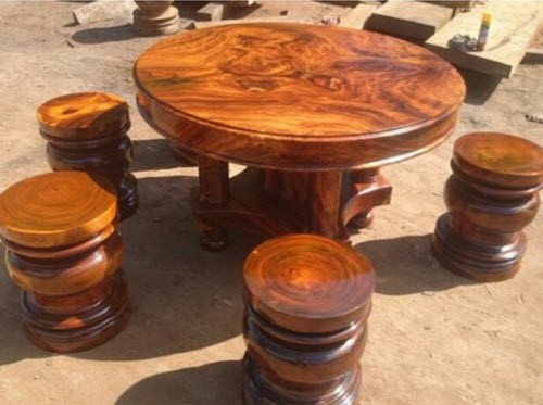 Round wooden table with carvings