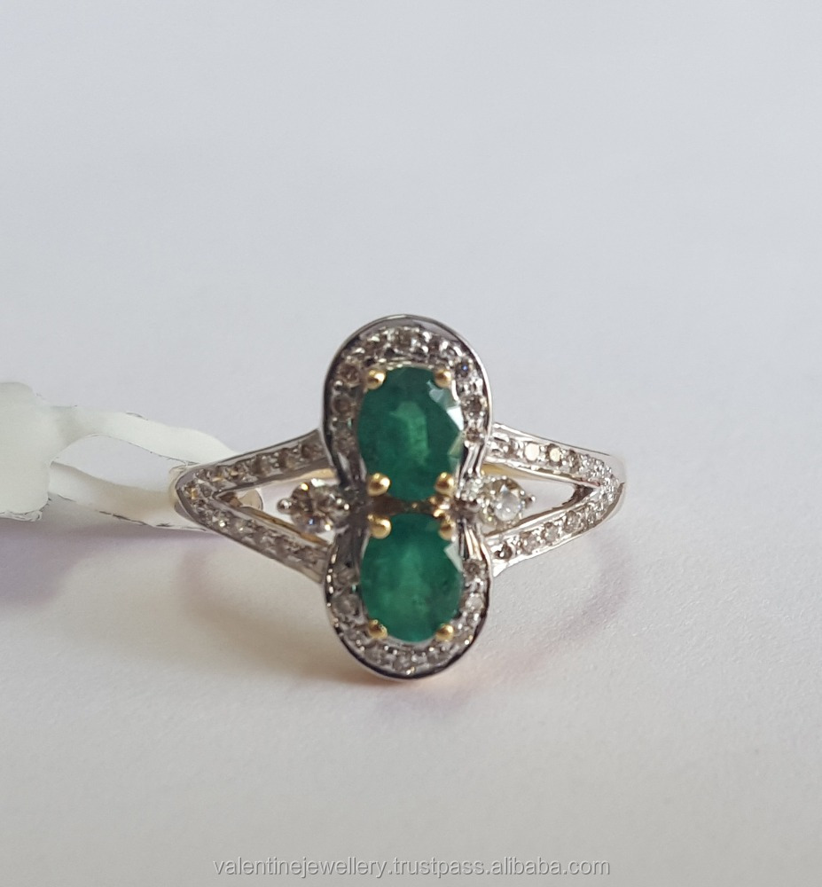 Pave Set Diamonds Framing Two Emerald Ovals In Pure Gold To Shop