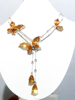 Silver necklace set with citrine with white sapphires