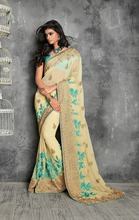 Cream colored pure chiffon saree.