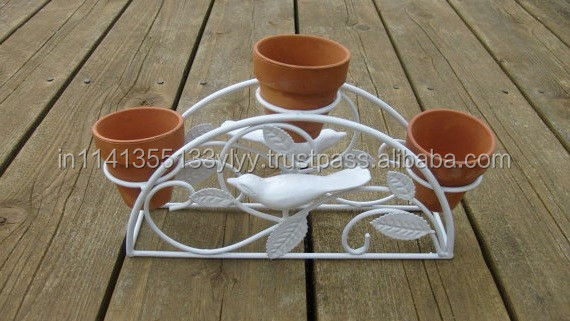 Wrought Iron Garden Decor & Planters