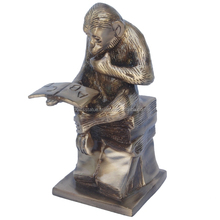Brass Sitting book reading Monkey by Aakrati