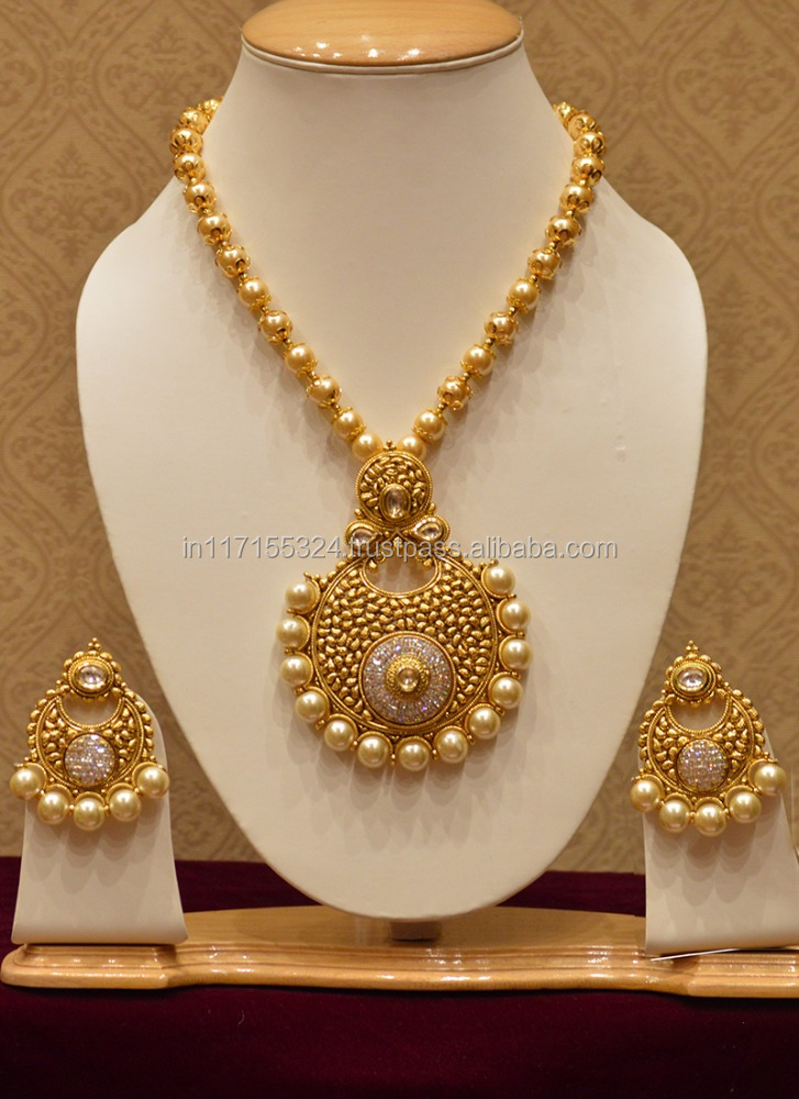 Luxurious big pearls and diamond necklace set temple jewellery