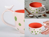 White clay cup with red dots
