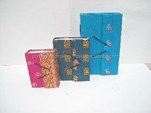 custom made sari fabric covered notepads in varying sizes made from recycled sari fabrics