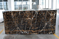 Black and gold marble blocks and marble tiles