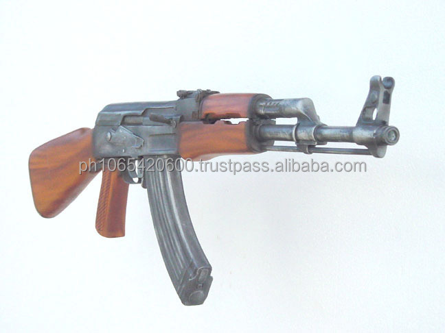 Variety of more than 20 realistic fiberglass guns and war related items