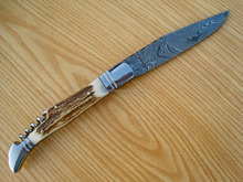 A SLIM/SMART STAG HORN HANDLE DAMASCUS STEEL LAGUIOLE KNIFE WITH CORK SCREW