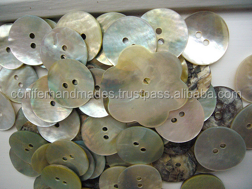 mother of pearl shell shirt buttons made in assorted sizes for clothing manufacturers and jewelry designers