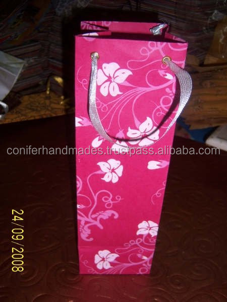 custom made wine bottle bags made from eco friendly handmade papers with ribbon handles suitable for wine stores