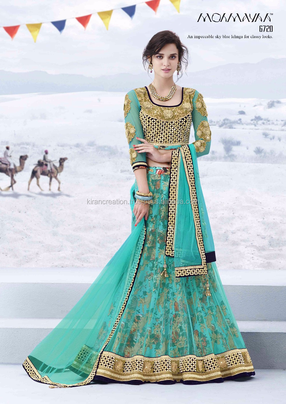 CREAM COLOR LEHENGA IN NET FABRIC .IT IS DETAILED WITH RESHAM, STONE WORK AND GLITTER PRINT.