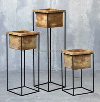 Set of 3 pedestal steel framed planters with concrete pots in Contemporary design