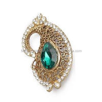 vintage jewelry brooches with green crystal and golden look combination