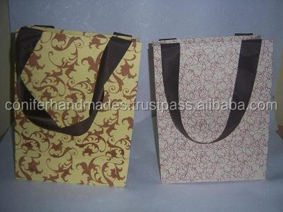 silk screen printed handmade paper bags made from cotton rag handmade paper with satin ribbon handles in size 10 *7 *3 inches