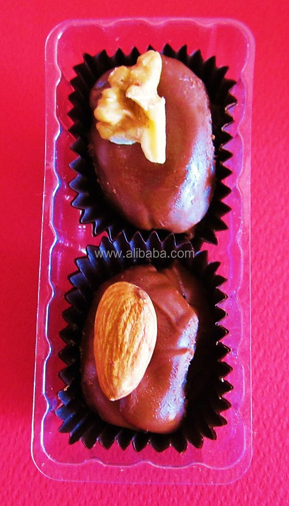 Chocolate Covered Dates ( after stuffed with Nuts )