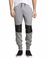 moto sweatpants with lamb leather trim. Drawstring waistband; ribbed leather panel at back