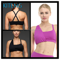 Kiteng comfortable yoga sports bra with crisscross stapes on the back wicking fabric and padding Office In United States