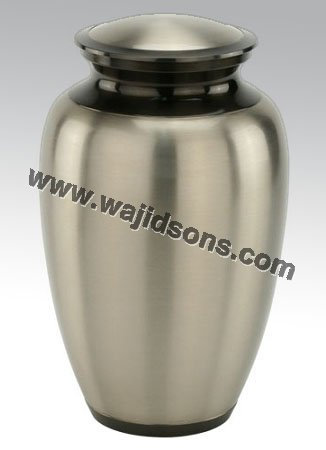 fancy brass rounded urn for cremation | red urn centerpiece | marble made urn manufactured by Royal De Wajidsons