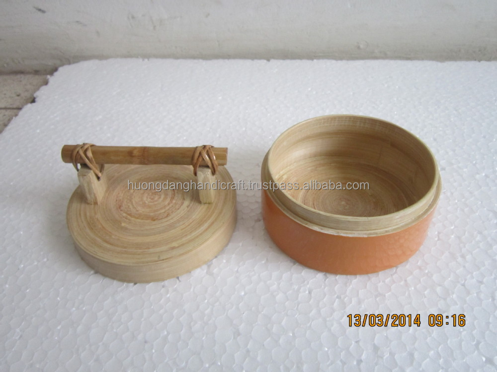 cylinder - shaped natural spun coiled bamboo box, handle made by invory bamboo and rattan fiber
