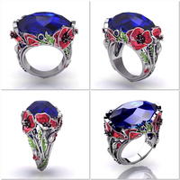 Designer white gold rings with 17 ct tanzanite