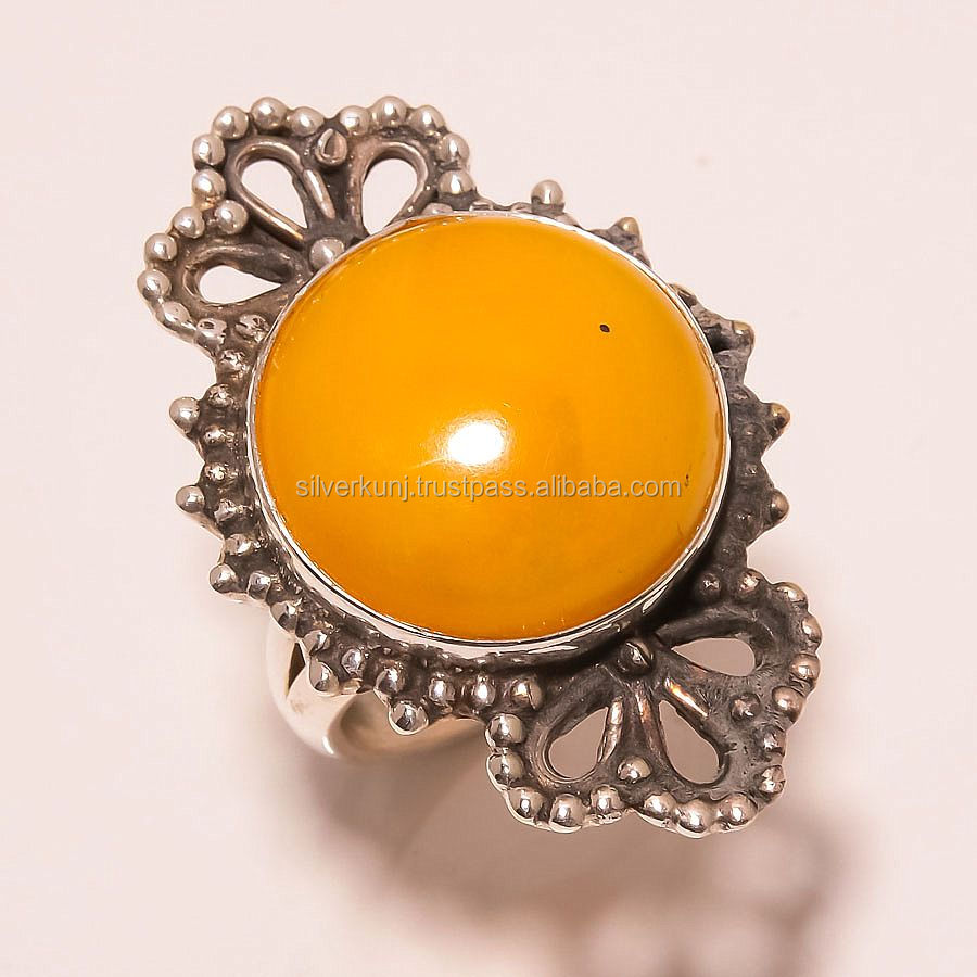 marvelous yellow amber round gemstone tribal style handmade artisan silver ring jewellery supplier