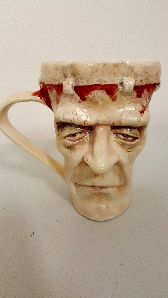 Sculpted coffee mug. Sculpted, poured painted by hand