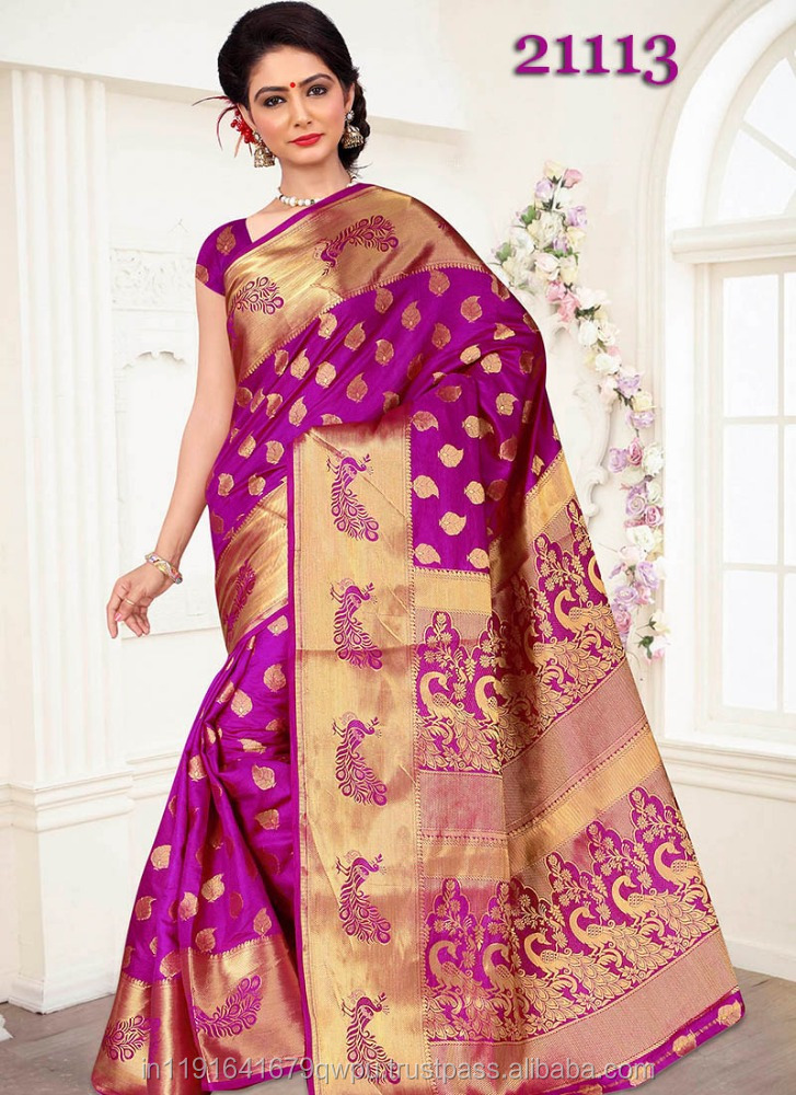 MANUFACTURER OF HEAVY ZARI WORK DESIGNER BANARASI SILK TRADITIONAL WEDDING SAREES IN SURAT