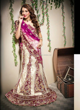 Eye- chtching net beige wedding reception wear designer lehenga choli - Models in lehenga choli - Gujrati lehenga choli online
