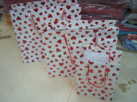heart design foil stamped paper bags in various sizes suitable for gifting and for promotions