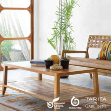 A modern and contemporary teak wood coffee table with a open shelf to store living necessities