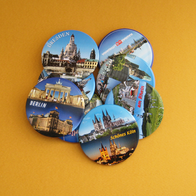 Round souvenir fridge magnets