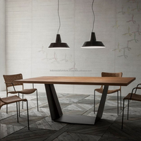 Dining table with metal base , suar wood