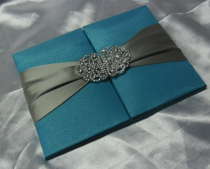 ivory silk wedding invitation folio wrapped in ivory satin ribbon with rhinestone clasp folio invitation