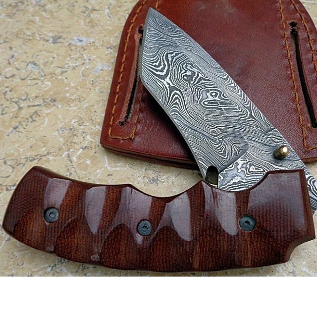 Damascus steel folding knife with micarta