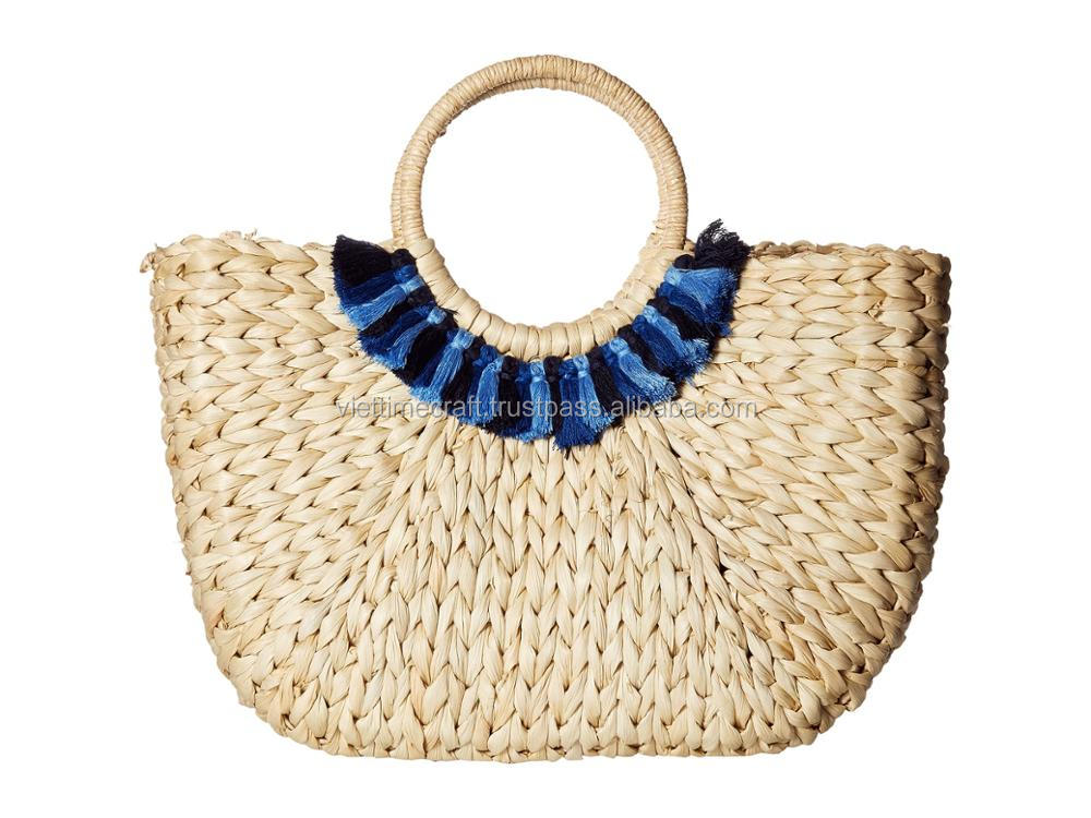 Water hyacinth pompom hobo bag with 3 natural tassels