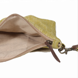 Hand pouch in nice green cotton material . Can be used as cosmetic pouch.