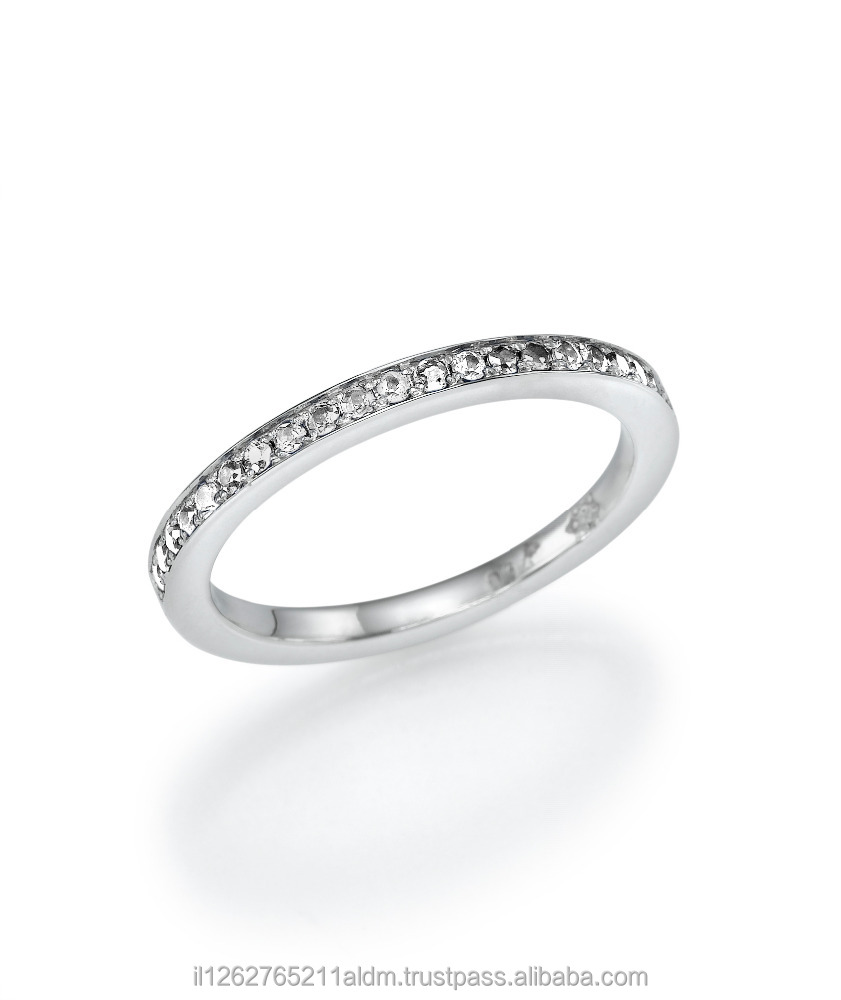 18K Gold Eternity Ring set with19 White Diamonds of 0.20ct, set in channel setting technique.