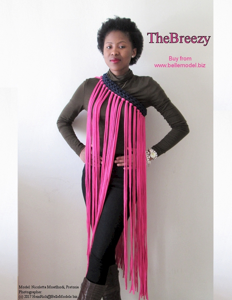 TheBreezy. A macrame dress. A fashion accessory that is worn over or with other clothes.