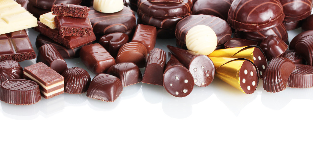 Various Chocolates and Pralines, Sweets, Chocolate Bars, Pralines, Truffel, Cherry Liqueur from leading brands and companies
