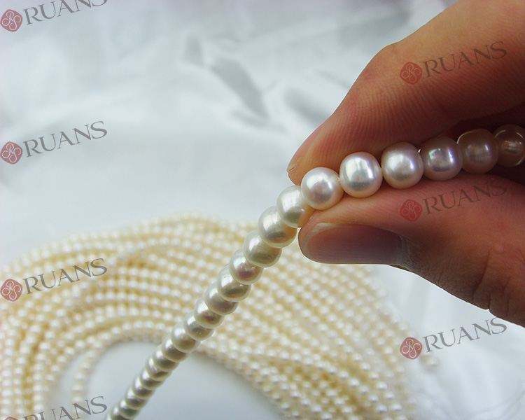 6.5-7 mm AA2 grade potato shape white freshwater pearl strands wholesale