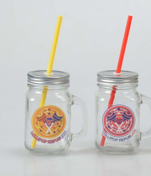 Glass mason mug with straw for drinking