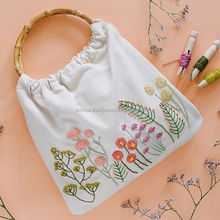 Hand embroidery linen bag with bamboo handles