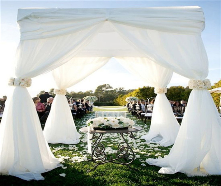 big inflatable wedding tent, backdrop with banjo pipe drape