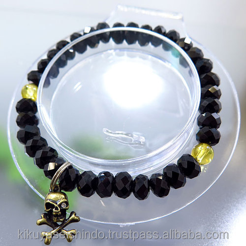Black Spinel Bracelet with skull and crossbones and two Yellow Crystals, cool bracelet made in Japan, kikuya seishindo