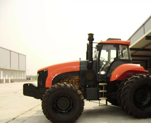 Pakistan wheeled tractor towing farm machinery..