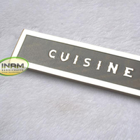 "Nautical wooden name plate decorated with brass inlay work ""CUISINE"""