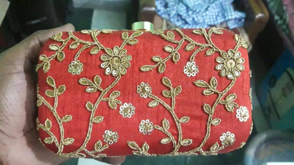 Sequence embroidery designer clutch