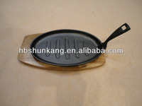 Cast iron sizzling plate with wooden boards