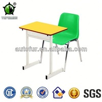 Colorful old school desks with chairs, school furniture