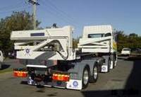 SIDE LOADER TRUCKMOUNTS white